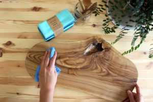 Cleaning spill on cutting board with Cheeks Ahoy unpaper towels
