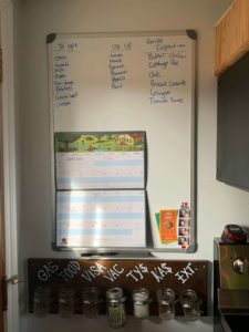 Tyler Scott's family uses a white board in their kitchen to create lists of things to purchase, items to use up, and inspiration for their weekly meals. This approach helps them to reduce the number of trips they make and also helps to avoid food waste.